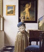 A Young Woman Standing at a Virginal JanVermeer