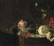 A 'Roemer' with white wine, a partially peeled lemon, cherries and other fruit on a silver plate with a rose and grapes on a stone ledge simon luttichuys